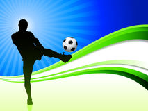 Soccer Player on Abstract Wave Background Royalty Free Stock Photo