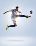Soccer player in action. Football soccer player in action   on color background Stock Photos