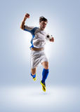 Soccer player in action. Football soccer player in action   on color background Royalty Free Stock Photos
