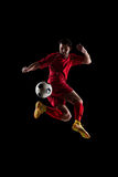 Soccer player in action. Football soccer player in action  isolated on black background Stock Photo