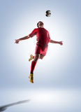 Soccer player in action. Football soccer player in action  isolated on color background Royalty Free Stock Photo