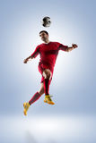Soccer player in action. Football soccer player in action  isolated on color background Stock Image