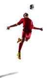 Soccer player in action. Football soccer player in action  isolated on white background Royalty Free Stock Image