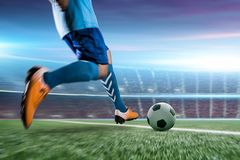 Soccer player in action kick ball at stadium. stock photo