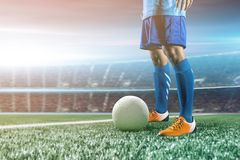 Soccer player in action kick ball at stadium. royalty free stock images
