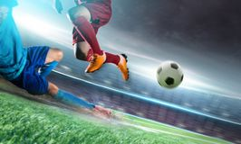 Soccer player in action kick ball at stadium. royalty free stock photography