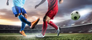 Soccer player in action kick ball at stadium. royalty free stock image