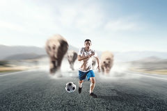Soccer player in action. Mixed media Stock Photos