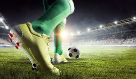 Soccer player in action. Mixed media. Soccer player at stadium kicking ball. Mixed media royalty free stock images