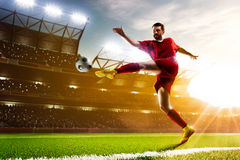 Soccer player in action. On night stadium background Stock Photography