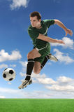 Soccer Player in Action. Over sky with clouds Stock Photos