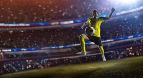 Soccer player in action stadium. Soccer player in action, stadium defocus royalty free stock photography