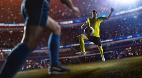 Soccer player in action stadium. Soccer player in action, stadium defocus stock photos