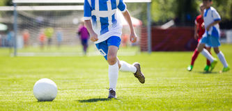 Soccer Player Action On Stadium. Youth Football Tournament Game Stock Image