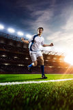 Soccer player in action sunset Stock Photos