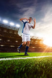 Soccer player in action sunset Stock Photography