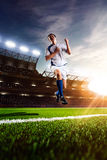 Soccer player in action sunset Royalty Free Stock Image