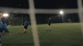 Soccer player in action on sunset stadium background, football man professional training at night stock video