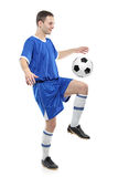 Soccer player with a ball. Isolated against white background stock image