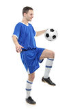 Soccer player with a ball. Isolated against white background stock photography