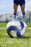 Soccer player and ball Royalty Free Stock Photos