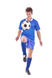 Soccer player with a ball Royalty Free Stock Photography