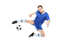 Soccer player with a ball in action. Isolated on white background stock photos