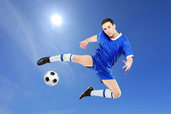 Soccer player with a ball in action Royalty Free Stock Images