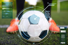 Soccer player with ball on football field Royalty Free Stock Photos