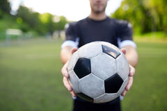 Soccer player with ball on football field Stock Images