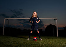 Soccer Player with Ball and Goal at Sunset Royalty Free Stock Photos
