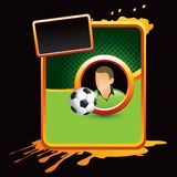 Soccer player and ball on orange splattered banner Stock Photos