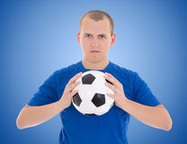 Soccer player with a ball over blue royalty free stock image