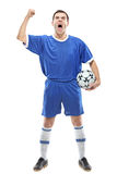 Soccer player with a ball screaming Royalty Free Stock Photo