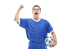 Soccer player with a ball screaming Stock Image