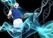 Soccer player with ball and with stone dna chains and black background and blue lights. Digital composite of soccer player with ball and with stone dna chains Royalty Free Stock Photos