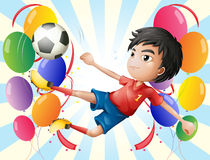 A soccer player with balloons Stock Photo