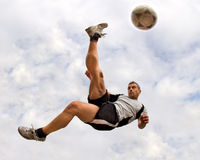 Soccer player in a bicycle kick. Soccer player doing a bicycle kick Royalty Free Stock Photography