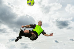 Soccer player. In a bicycle kick royalty free stock image