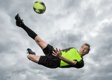 Soccer player. In a bicycle kick royalty free stock images