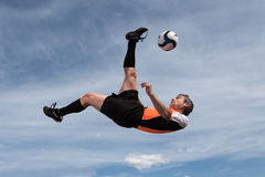 Soccer player. In a bicycle kick Stock Photos