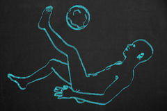 Soccer player in a bicycle kick pose drawed with blue chalk on a Stock Photos