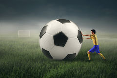 Soccer player with a big ball Stock Image