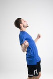 Soccer player blue shirt with ball isolated studio Stock Photo
