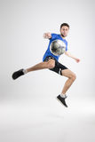 Soccer player blue shirt with ball isolated studio royalty free stock images