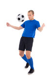 Soccer player in blue stop the ball with his chest isolated on w Royalty Free Stock Photos