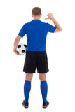 Soccer player in blue uniform showing on her back isolated on wh Stock Photos