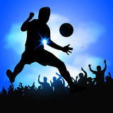 Soccer player celebrates goal. Silhouette soccer player celebrates goal with huge crowd Stock Photo