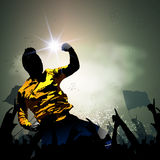 Soccer player celebrating with crowd. Soccer player celebrating with huge crowd fan  background Royalty Free Stock Image
