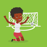 Soccer player celebrating scoring goal. African-american female soccer player celebrating scoring goal. Young soccer player kneeling with raised arms on the Royalty Free Stock Image